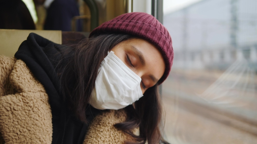 Young Asian Woman In Respirator Mask Sleeping In A Train. Ecological Pollution Air Infection Coronavirus Concept. 4K Slow Motion Footage. Tokyo, Japan. | Shutterstock HD Video #1045220815