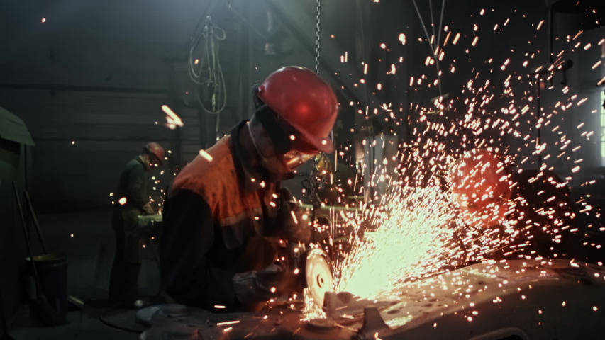 Manufacture of Railcar or Carriage, Train Wagon Production, Factory Workers are Welding in Protective Helmets and Glasses, Beautiful Epic Shot, Dolly Out, Slow Motion | Shutterstock HD Video #1045233025