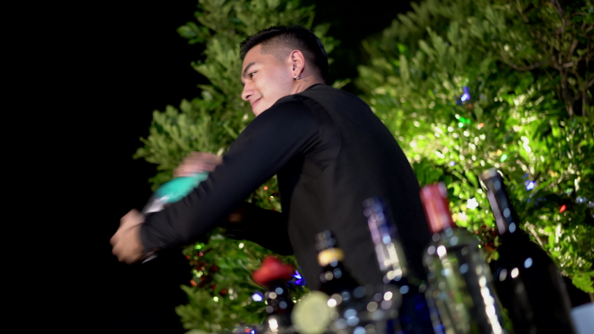 Asian barman is making cocktail at birthday night party. Handheld shot and Real life, Night party concept | Shutterstock HD Video #1045340305