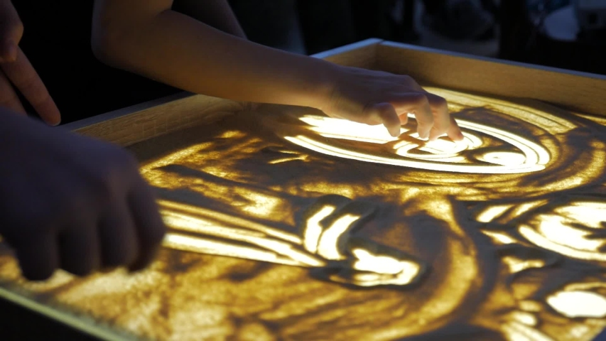 Sand animation. Child drawing sand on a white screen with hands | Shutterstock HD Video #1045396285