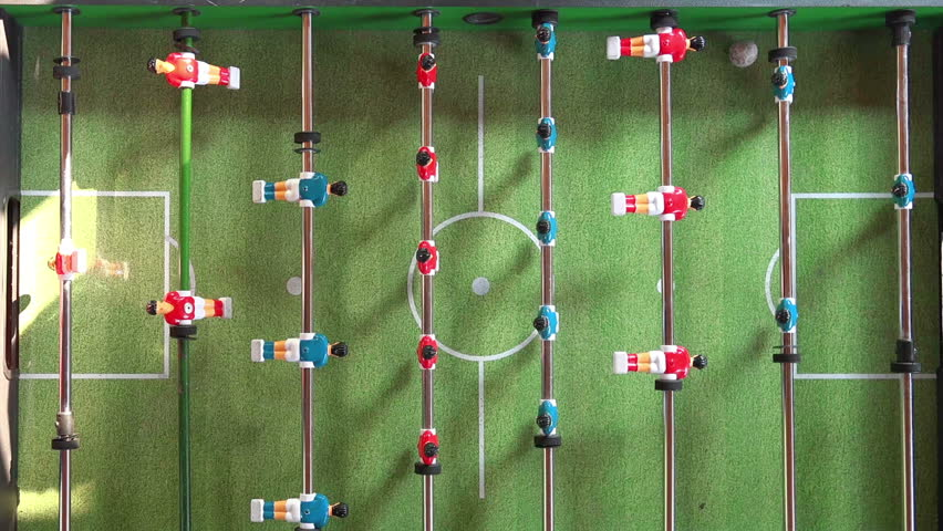 Vintage Foosball Known as Table Soccer, Blue and Red Players in Football Kicker Game, Selective Focus, Retro Cinematic Tone Effect
