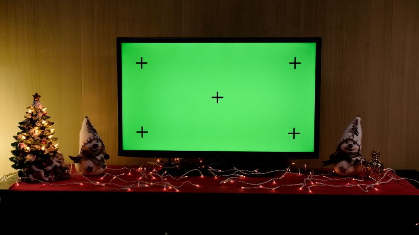 Christmas TV with green screen composited. TV or television - green screen - room - on the table. Christmas time | Shutterstock HD Video #1046797525