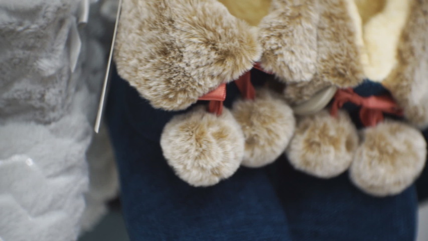 Soft insulated slippers on a store shelf. | Shutterstock HD Video #1046986315