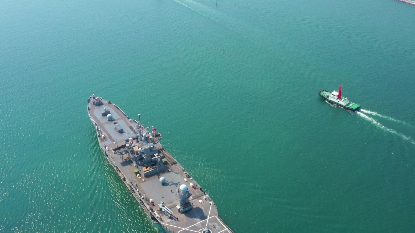 Aerial view of naval ship, battle ship, warship, Military ship resilient and armed with weapon systems, though armament on troop transports. support navy ship. | Shutterstock HD Video #1047119005