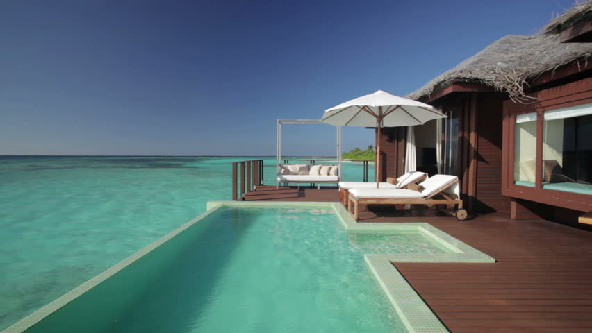 overwater bungalow terrace with pool and audio