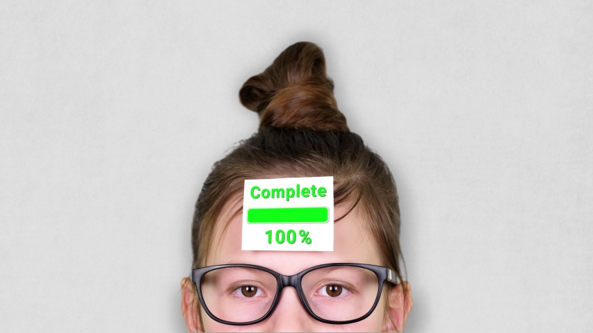 Close-up, a smart teenager face, a child in glasses, with a sticker on his forehead. an animation of Analysis process takes place on the sticker. | Shutterstock HD Video #1047168295