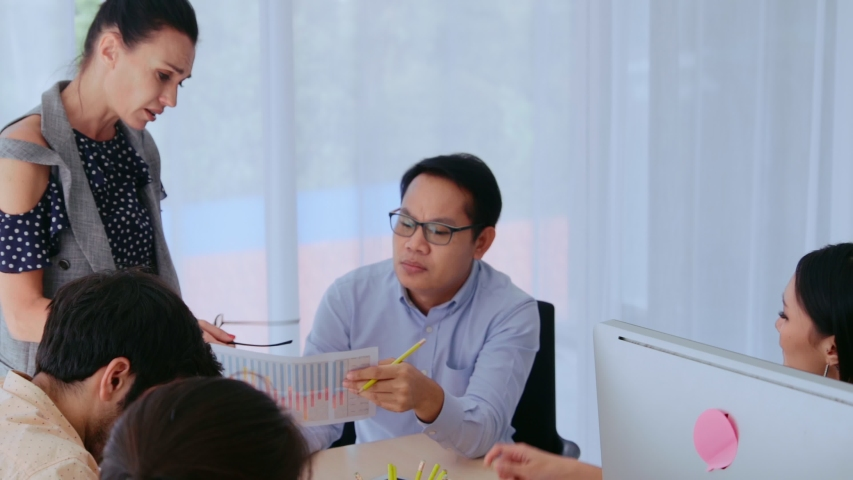 Unhappy business people in group meeting in office. The team is frustrated because of project failure. Business problem and crisis concept. | Shutterstock HD Video #1047189715