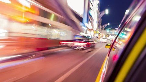 TOKYO - MAY 12th 2015: Point of view time-lapse (hyperlapse)  through the city at night by taxi. Tokyo, Japan