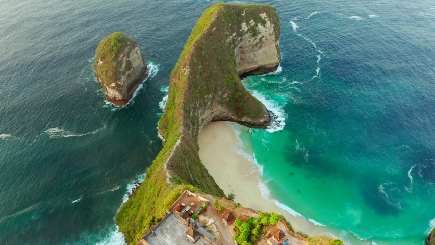Aerial view at sea and rocks. Turquoise water background from top view. Summer seascape from air. Kelingking beach, Nusa Penida, Bali, Indonesia. | Shutterstock HD Video #1048309405