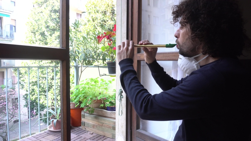 Europe, Italy, Milan - Man at home in quarantine with mask plays music from the windows - italian  flash mob during pandemic of n-cov19 Coronavirus | Shutterstock HD Video #1048433815