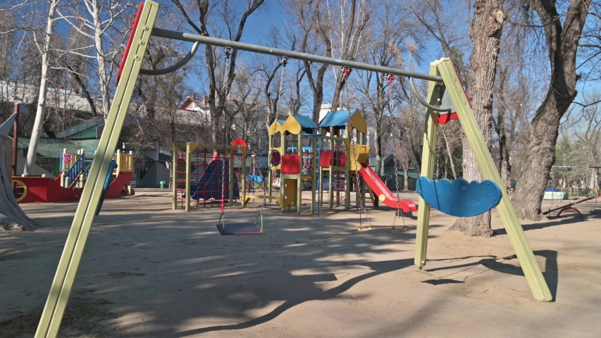 Chisinau, Moldova - March 17, 2020: Empty children playground in cathedral square park in the center of city during quarantine by reason of coronavirus AKA covid-19 virus threat. State of emergency | Shutterstock HD Video #1048516855