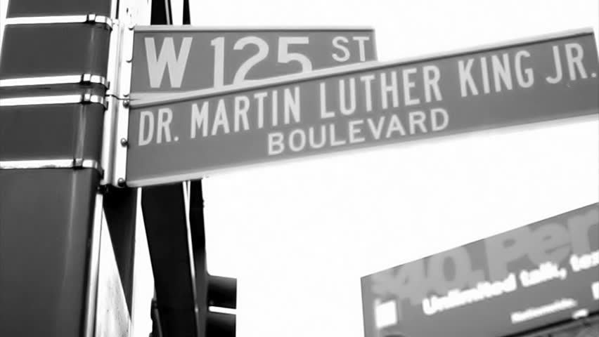 NEW YORK - FEB 9, 2010: vintage style black and white 16mm film footage of 125 and Martin Luther King Blvd sign in Harlem NY. Harlem is a famous neighborhood in Uptown Manhattan, NYC, USA.