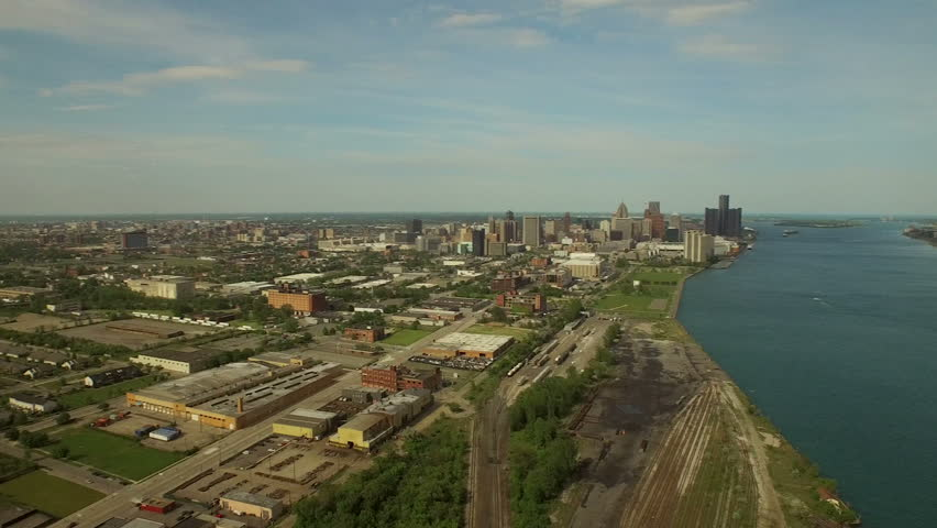 Detroit Aerial v87 Flying over Hubbard-Richard area panning right with cityscape and bridge views. | Shutterstock HD Video #10487825
