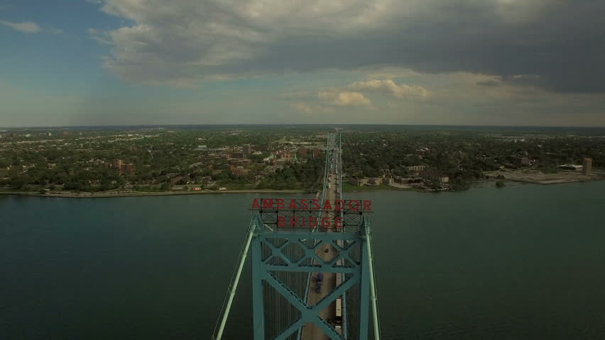 Detroit Aerial v82 Flying low over Ambassador Bridge panning down to vertical shot.