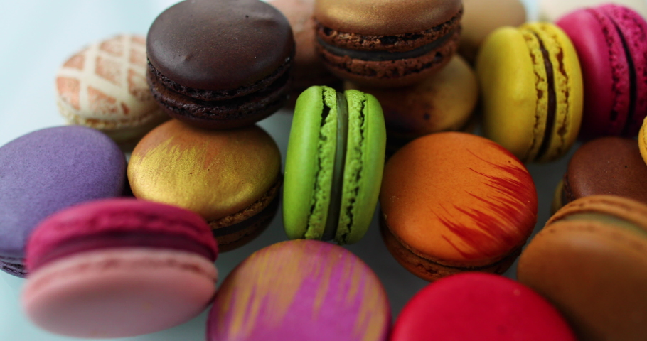 Macarons dessert. Many cute colors Assortment of pastel colored macaron of different flavors. | Shutterstock HD Video #1049488255