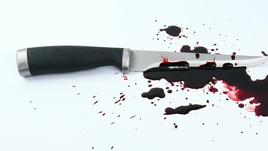 Move the camera angle from left to right, Blood knives are spread over on a white background.   Shutterstock HD Video #1049493565
