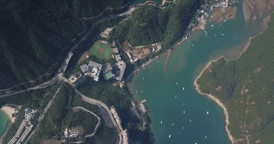 Aerial view of Tai Tam Tuk Reservoir with Dam in the Redhill Penisula of Hong Kong  | Shutterstock HD Video #1049563945