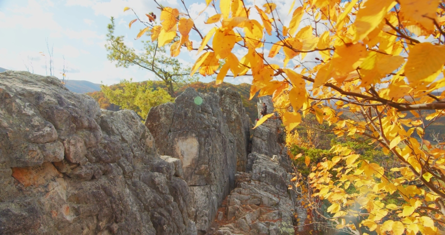 Couple at the Top of Seneca Rocks, West Virginia, Autumn | Shutterstock HD Video #1049616445