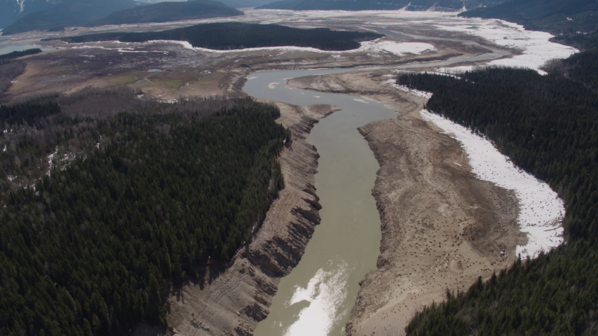 Aerial - Drone Top Down Dried Up Reservoir with Eroded Shores Kinbasket BC Canada 2 | Shutterstock HD Video #1049716435