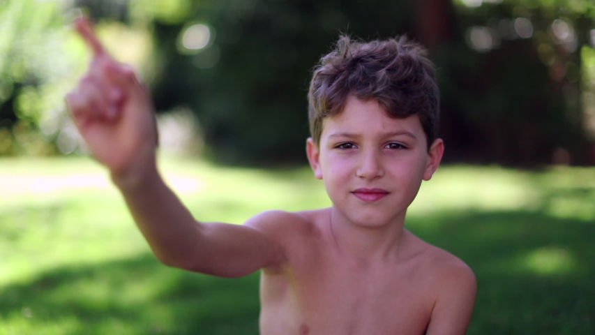 Child gesturing NO shaking finger refusing offer. Young boy negative gesture with hand | Shutterstock HD Video #1049719045