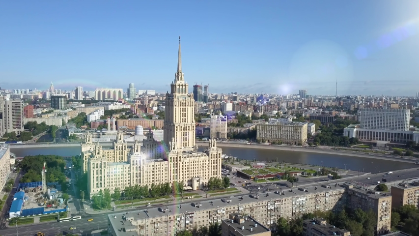 Aerial view of hotel Ukraine in Moscow. Old Soviet Russia Stalin high-rise skyscrapers in heart of modern Moscow City. Kutuzov avenue day traffic. Government building | Shutterstock HD Video #1049730175