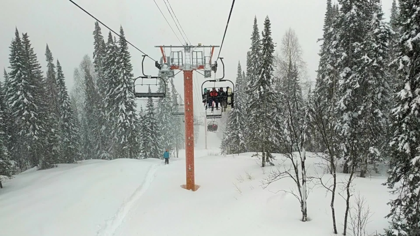 Chair lift in a ski resort | Shutterstock HD Video #1049884345