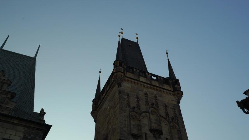 Charles bridge and Lesser town bridge tower in Prague, Czechia. Malostranská věž - Tilt down 4K. Culture and history from Czech republic. | Shutterstock HD Video #1050036745