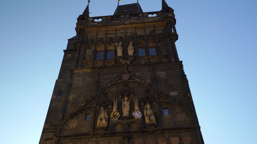 Famous Most old town bridge tower across Vltava river tower leading to charles bridge. Built by Charles IV and protected by UNESCO world heritage. Tilt down 4K | Shutterstock HD Video #1050036895