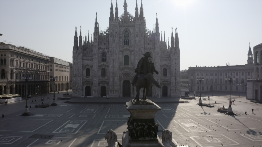 Everyday life in Milan, Italy during COVID-19 epidemic. Milano, Italian city and coronavirus lockdown. Aerial view of Piazza Duomo. Urban landscape seen from drone flying in sky | Shutterstock HD Video #1050082825
