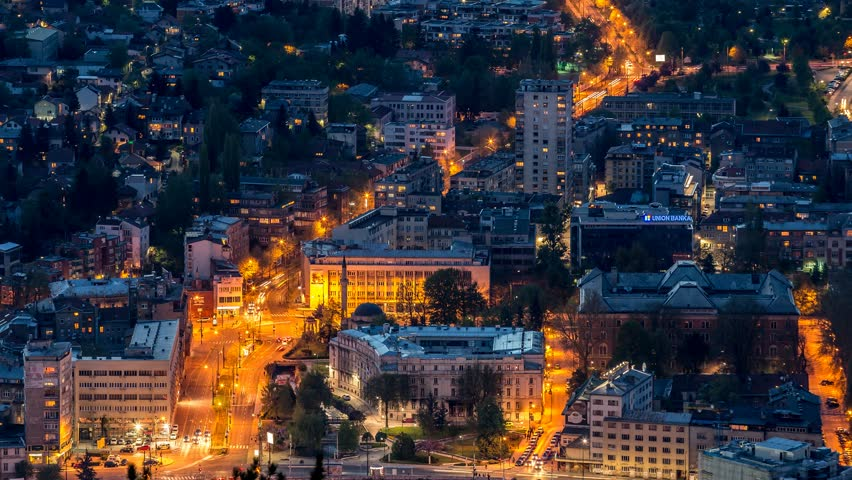 Panoramic Time Lapse of traffic in Sarajevo city, the capetown of Bosnia and Herzegowina, by night. 4K Time Lapse scene. Tilt Shift above using emotimo.