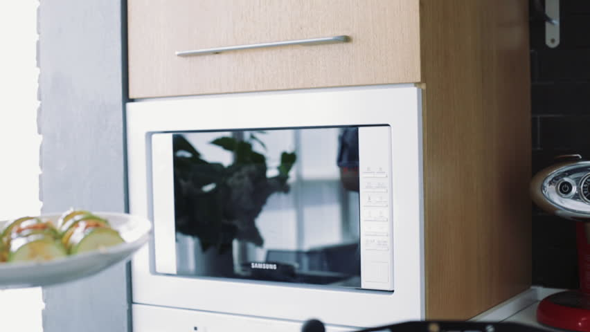 Placing a dish into microwave
