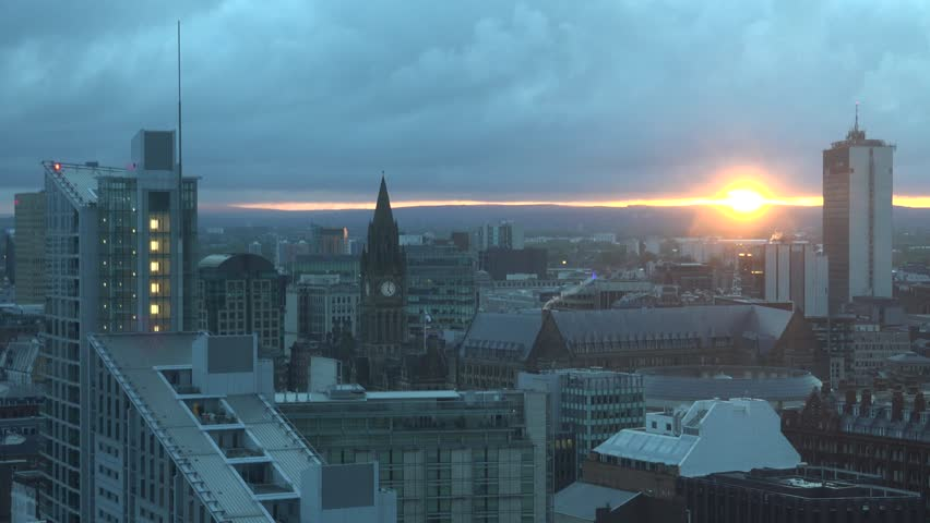 ULTRA HD 4K Aerial view of Manchester skyline at  sunset or sunrise, iconic place by day
