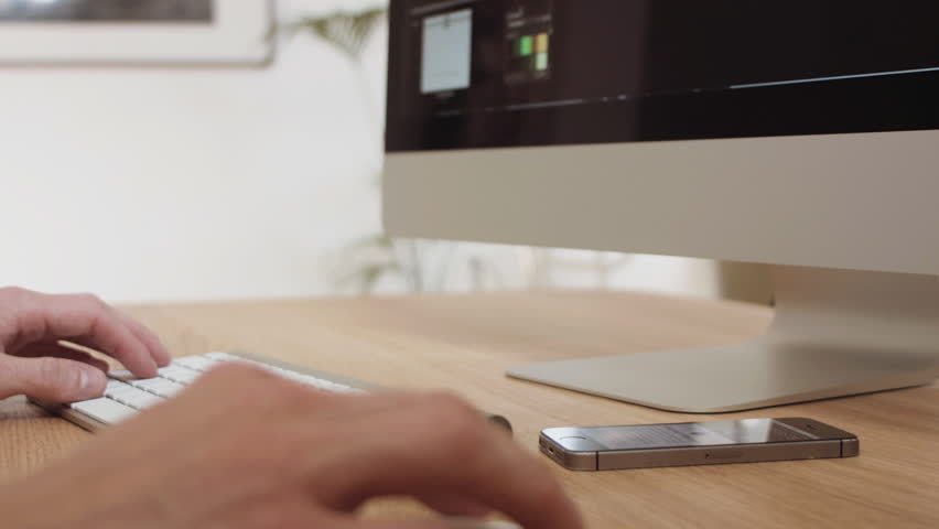 Web designer multitasking on a modern computer workspace | Shutterstock HD Video #10580411