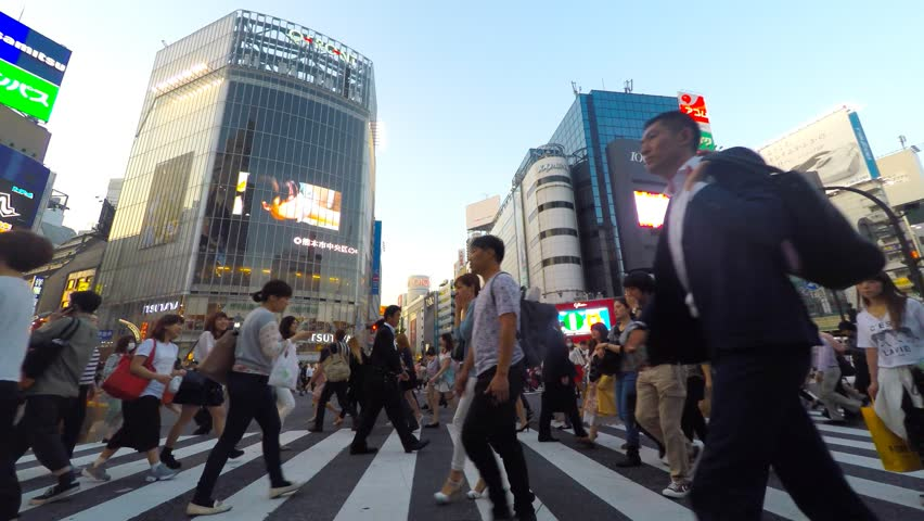 Tokyo, Japan - May 14, 2015: Pedestrians at Shibuya crossing, The famous scramble crosswalk also known as Shibuya scramble is used by over 2.5 million people on daily basis