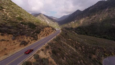 Extreme ride on the red Lamborghini Gallardo at Angeles Crest Hwy. Shooting from a helicopter.