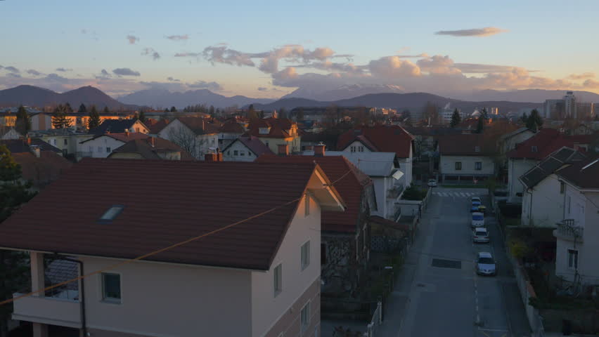 AERIAL: Suburban houses at sunrise