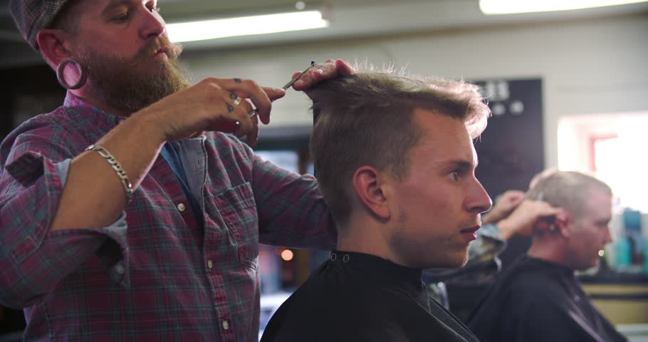 Male Barber Giving Client Haircut In Shop #10675265