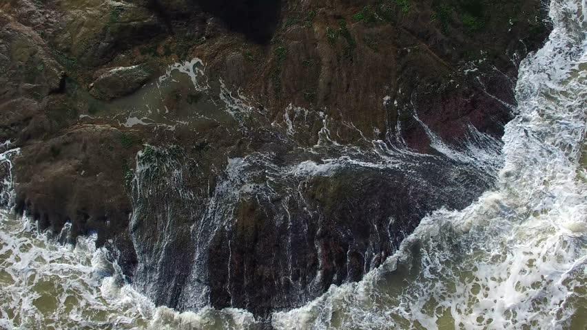 Aerial Drone footage of Waves Rushing Rocks