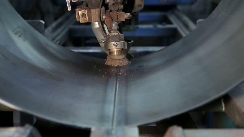 Video-footage: Submerged arc welding process of a vessel. Industrial machine   Shutterstock HD Video #10704515