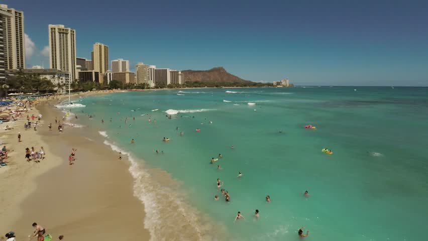 Aerial Shoot Kahanamoku Beach.  Waikiki. Honolulu. Island O'ahu. Hawaii. View of the beach with Pacific Ocean and tall buildings.