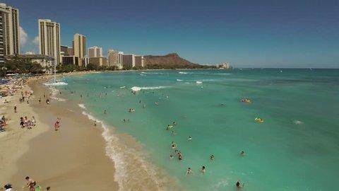 Aerial Shoot Kahanamoku Beach.  Waikiki. Honolulu. Island O'ahu. Hawaii. View of the beach with Pacific Ocean and tall buildings.