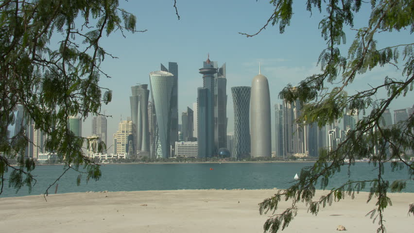 Qatar Doha skyline seen through trees across the bay   Shutterstock HD Video #10727585