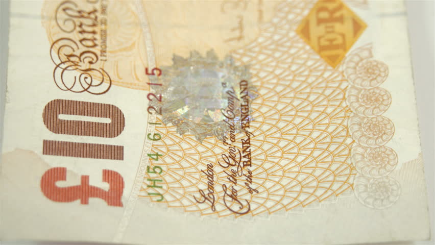 Side view of the 10 Pounds bill on the table. Showing the every details of the bill. | Shutterstock HD Video #10758395