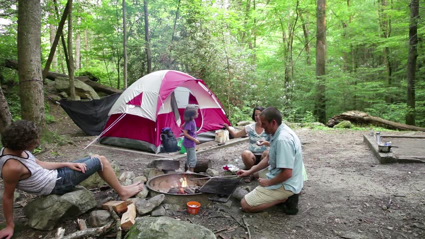 Family Camping In The Woods Tent Forest Grilling Over Fire