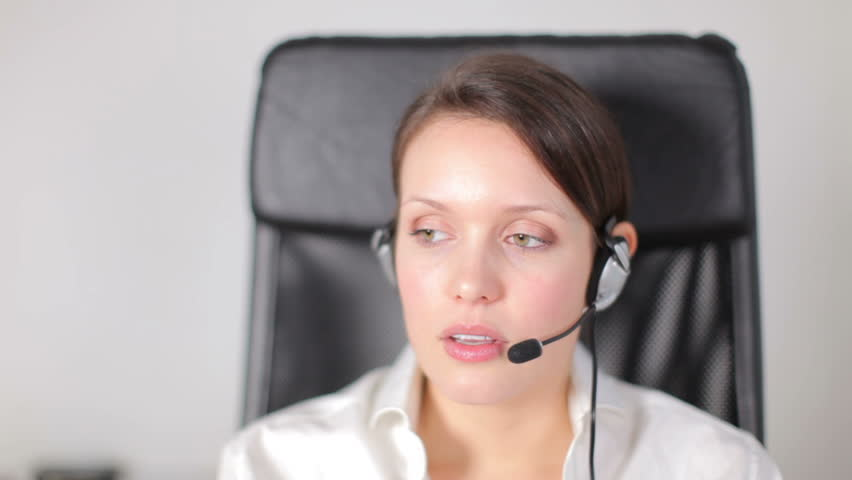 a pretty customer service operator or secretary, getting annoyed with a client