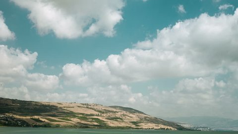 Breeze clouds running over the Galilee sea, Kinneret and Jordan river, with mountains and Tiberias on background, Israel, Middle east
