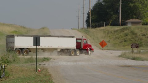 Industrial truck driving down a rural dirt road in Nebraska.