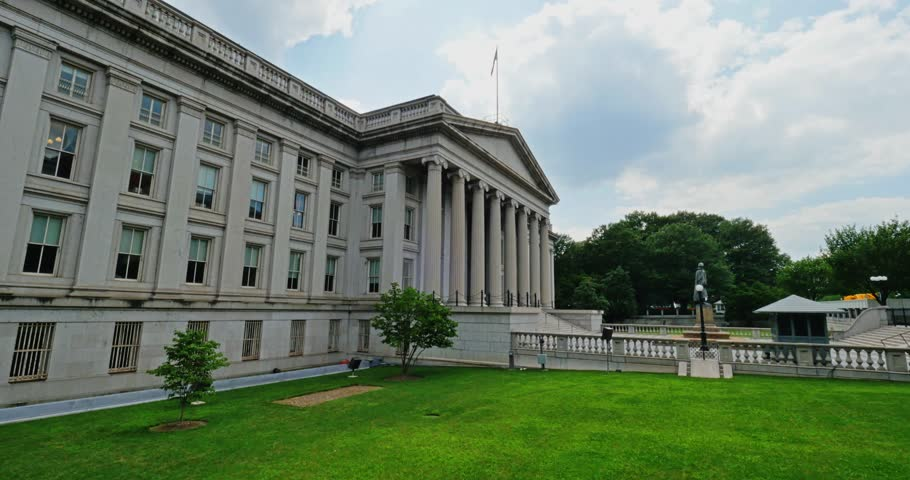A daytime establishing shot of the U.S. Department of The Treasury building in Washington, D.C.