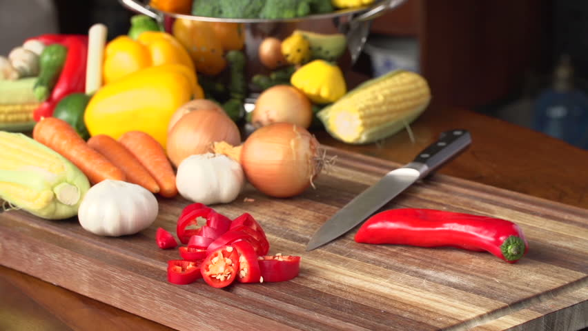 Chef Cutting Red Pepper With Vegetables In The Background,South Africa   HD  Stock Video