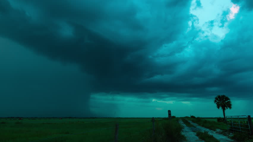 4K - Time-lapse of severe pulse thunderstorm with intense lightning over the southern Florida wetlands at dusk.